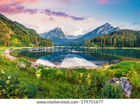 Great summer landscape on the Obersee lake. Colorful morning view in the Swiss Alps, Nafels village location, Switzerland, Europe. Artistic style post processed photo. #579755677