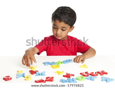 Toddler Playing with Alphabets