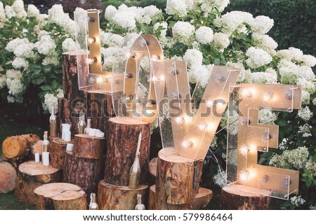 Decorated meadow for wedding ceremony. Royalty-Free Stock Photo #579986464
