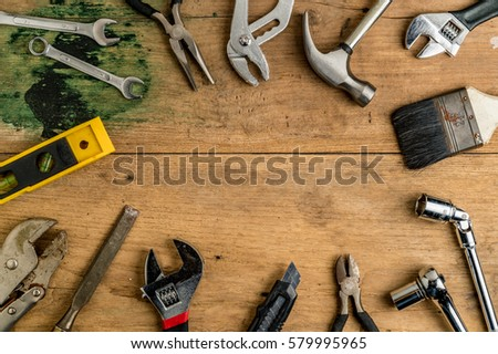 Top view of DIY tools on wooden desk #579995965