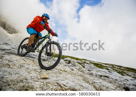 View of cyclist riding mountain bike on trail in Dolomites,Tre Cime di Laverado, South Tirol, Italy #580030651