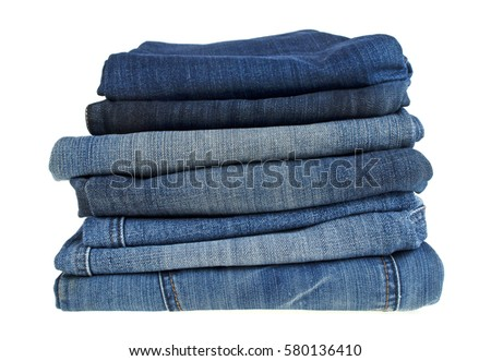 Lot of different blue jeans isolated on white background #580136410