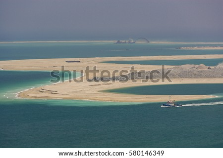 DUBAI, UNITED ARAB EMIRATES - MAY 7, 2006: Land reclamation in progress, creating new land area in Gulf, for development. #580146349