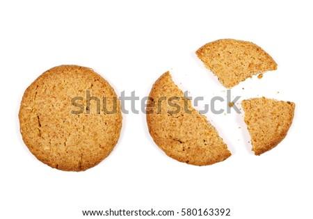set round wholewheat biscuits with hazelnut isolated on white background #580163392
