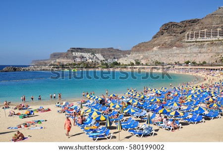 Beach of Los Amadores in Puerto Rico resort on gran canaria canary island in spain Royalty-Free Stock Photo #580199002