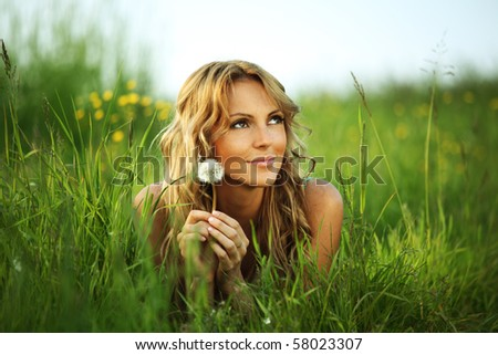 woman with dandelion