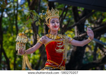 BANGKOK, THAILAND - JANUARY 14 2016: Participants take part in the celebration of Thai Traditional Culture Festival at Lumpini Park #580270207