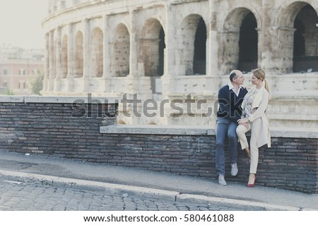 holidays, travel, tourism, people and dating concept - happy couple hugging over rome background