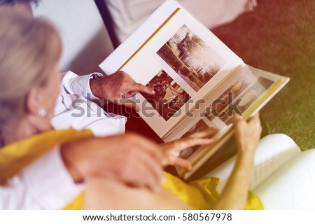 Photo Gradient Style with Senior Couple Look Photo Album Royalty-Free Stock Photo #580567978