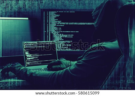 Internet crime concept. Hacker working on a code on dark digital background with digital interface around. Royalty-Free Stock Photo #580615099