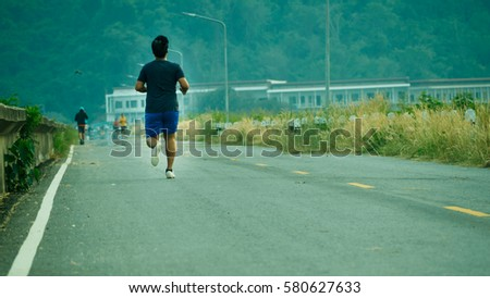 Blurry Picture of asian people  are Running in Outdoor Public Park Background - Lifestyle Sport Recreation Concept