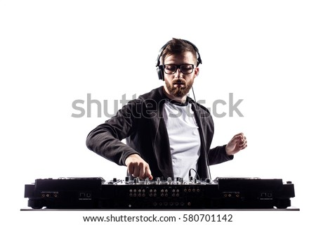 Young stylish man in glasses posing behind mixing console on white studio background. Royalty-Free Stock Photo #580701142