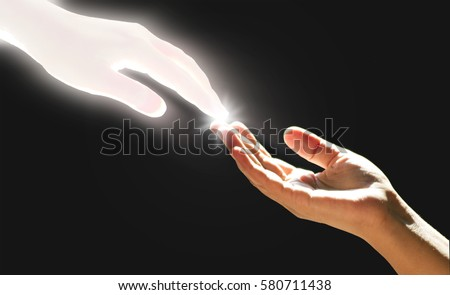 White God's Hand is Touching The Hand  Royalty-Free Stock Photo #580711438
