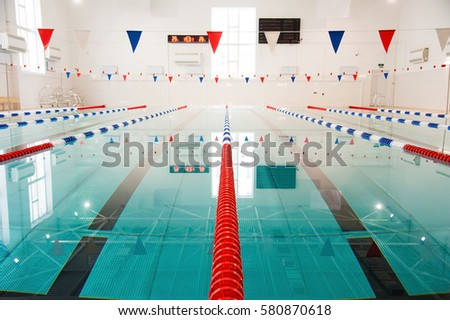 Interior of public swimming pool. Lanes of a competition swimming pool #580870618