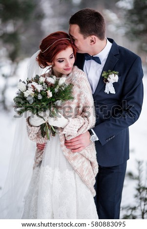 winter wedding in the forest bride and groom #580883095