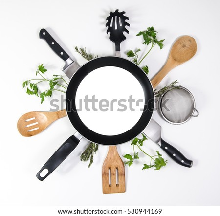 Concept layout for restaurant brochure, menus, presentation or advertising. Frying pan with blank copy space or room for text on top of kitchen utensils and parsley leaves. White background. #580944169