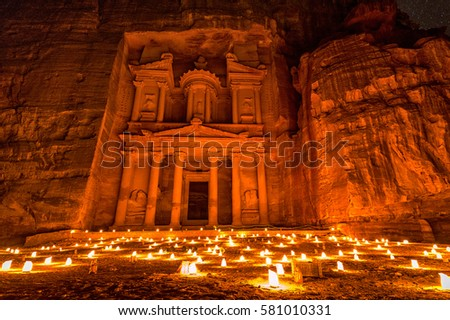 Experience Petra by night by walking the entire Siq to the Treasury to see part of the rock city by candlelight with over 1,500 candles, Petra, Jordan. #581010331