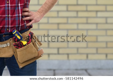 closeup of the worker with tools belt #581142496
