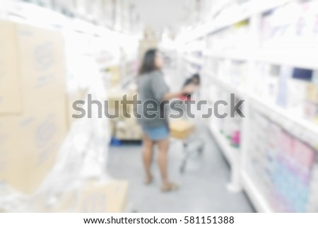 Picture blurred  for background abstract and can be illustration to article of Woman shopping at the supermarket #581151388