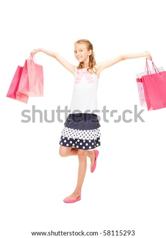 happy girl with shopping bags over white #58115293