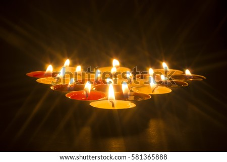 red and yellow candle with isolated black background #581365888