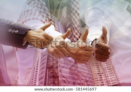 Group of businessman and women thump up for the good success story #581445697