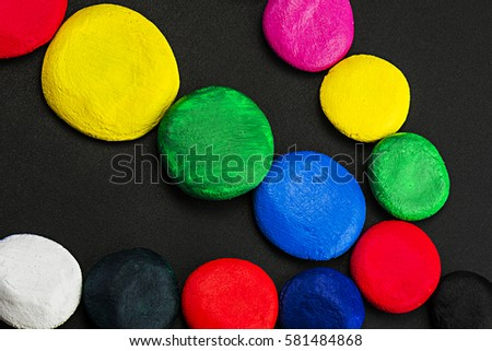 Colorful, bright, beautiful circles, laid out on a dark background, close-up #581484868