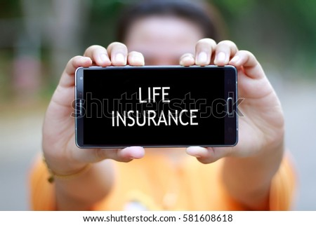 Smart Phone with word LIFE INSURANCE #581608618