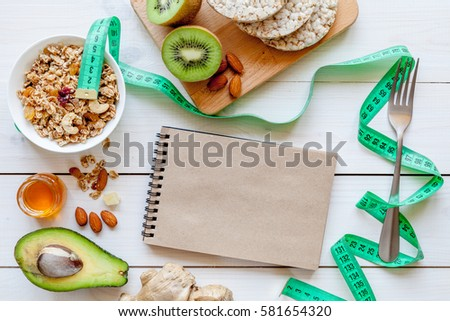 Concept diet - healthy food with muesli, honey, kiwi and cereals #581654320