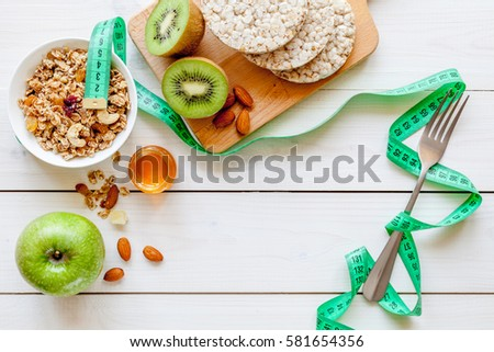 Concept diet - healthy food with muesli, honey, kiwi and cereals #581654356
