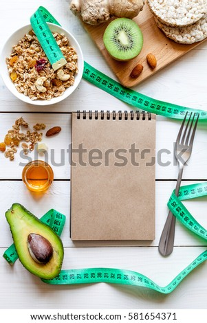 Concept diet - healthy food with muesli, honey, kiwi and cereals #581654371