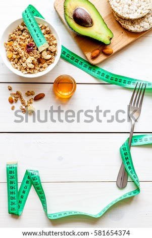 Concept diet - healthy food with muesli, honey and cereals #581654374