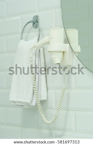 Towels on a stand #581697313