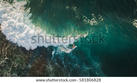 aerial shooting surfing Royalty-Free Stock Photo #581806828