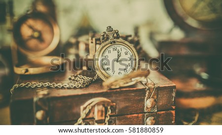 Antique compass old collection on a wooden treasure box in vintage style image. #581880859