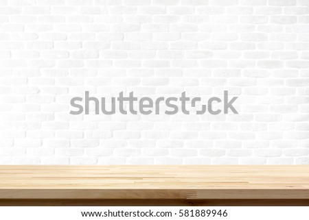 Wood table top on white brick wall background - can be used for display or montage your products (food)