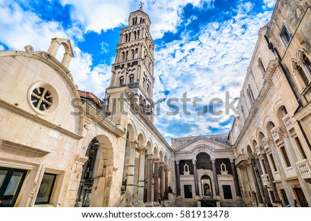 Marble ancient roman architecture in city center of town Split, view at square Peristil in front of cathedral Saint Domnius and  bell tower landmarks, Croatia. / Selective focus. Royalty-Free Stock Photo #581913478