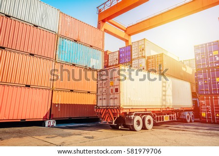 Business Logistics concept,Truck in container depot in import and export area at port,Container Cargo freight ship for Logistic Import Export  #581979706