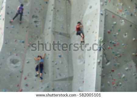 Blurred image background of climbers in climbing gym #582005101