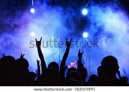 Silhouettes people at the rock concert #582019891