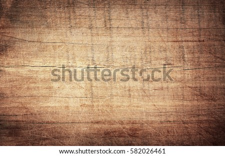 Brown scratched wooden cutting board. Wood texture Royalty-Free Stock Photo #582026461