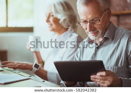 Pleasant aged man using tablet #582042382