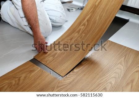 Man laying PVC-floor Royalty-Free Stock Photo #582115630