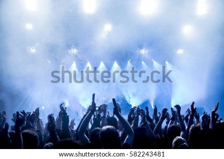 cheering crowd at a rock concert #582243481