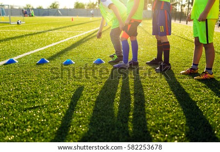 Soccer Football Training Session for Kids. Boys Training Football on the Pitch. Soccer Stadium in the Background Royalty-Free Stock Photo #582253678