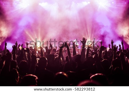 cheering crowd at a rock concert #582293812