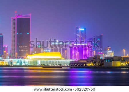 MANAMA, BAHRAIN, OCTOBER 22, 2016: Skyline of Manama with the Bahrain National theater during sunset, Bahrain. #582320950