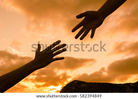 Giving a helping hand.  Royalty-Free Stock Photo #582394849