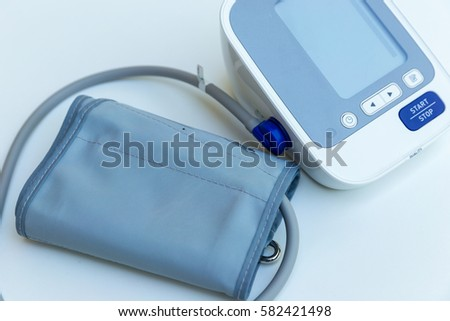 Digital Blood Pressure Monitor on white background #582421498