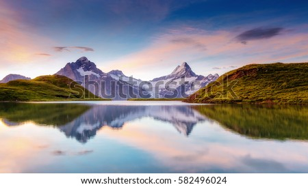 Great view of the snow rocky massif. Popular tourist attraction. Dramatic and picturesque scene. Location place Bachalpsee in Swiss alps, Grindelwald valley, Bernese Oberland, Europe. Beauty world. #582496024